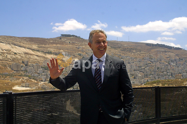 Quartet Middle East Envoy Tony Blair waves to pressmen during a visit to the northern West Bank city of Nablus on July 14, 2009. Israel on May 13 rejected a European Union call for the United Nations to recognise a Palestinian state by a certain deadline even if Israel and Palestinians fail to agree on a peace deal. . Photo by Nedal Shtieh