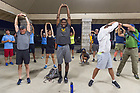 August 14, 2017; University of Notre Dame President Rev. John I. Jenkins, C.S.C., joins the pilgrims for a 6am stretching exercise before making the 19 mile trek from Vincennes to Oaktown, Indiana. As part of the University's 175th anniversary celebration, the Notre Dame Trail will commemorate Father Sorin and the Holy Cross Brothers' journey. A small group of pilgrims will make the entire 300+ mile journey from Vincennes to Notre Dame over  two weeks. (Photo by Barbara Johnston/University of Notre Dame)