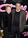 LOS ANGELES, CA - APRIL 18: Producer-director Ivan Reitman (R) and wife Genevieve Robert attend the Premiere Of Focus Features' 'Tully' at Regal LA Live Stadium 14 on April 18, 2018 in Los Angeles, California.