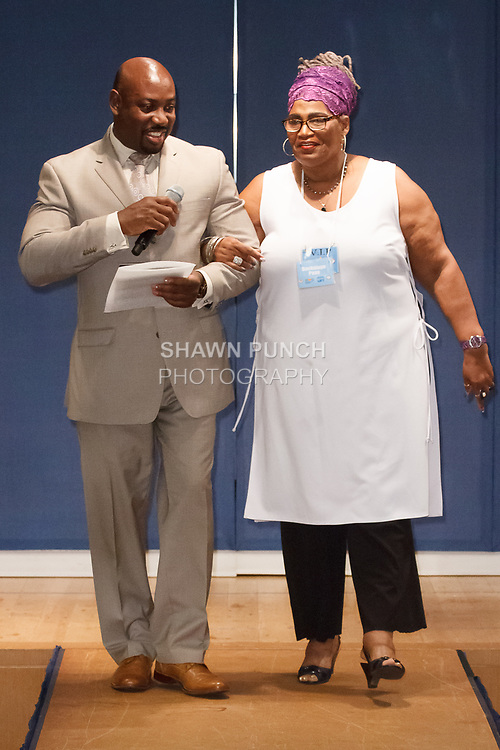 Jocelyn Badette (left) Principal of Maxwell CTE High school hands award to teacher, during the Teachers Rock The Runway fashion show presented by the United Federation of Teachers, at 52 Broadway in New York City, on May 31st 2018.