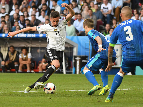 26.06.2016. Lille, France. UEFA EURO 2016 Round of 16 soccer match between Germany and Slovakia at the Pierre Mauroy stadium in Lille, France, 26 June 2016.  Julian Draxler (ger) covered by Martin Skrtel (Slovakia)