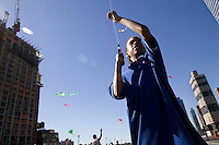 A boy flies a kite from the rooftop of the Port Authority bus terminal in New York City, USA, during the third annual Kite Flight event, 23 September 2007.