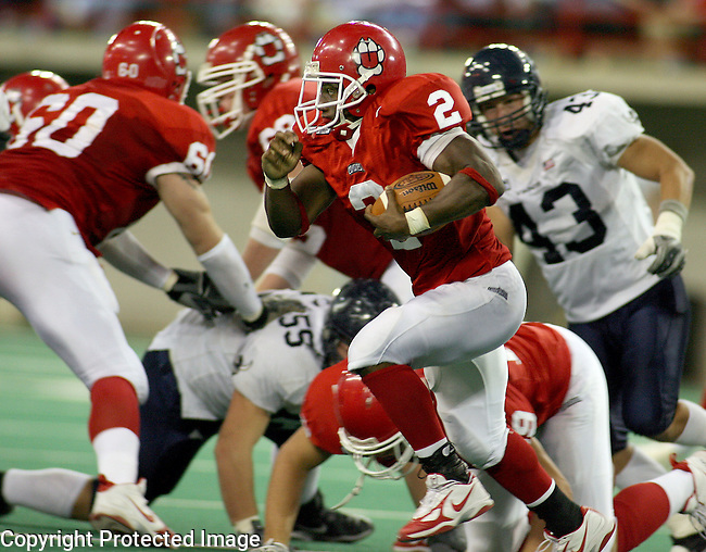 University of South Dakota's Amos Allen (2) scrambles for yardage against Western Washington University in the fourth quarter of their NCC game Saturday afternoon at the DakotaDome in Vermillion. (photo by Dave Eggen/Inertia)