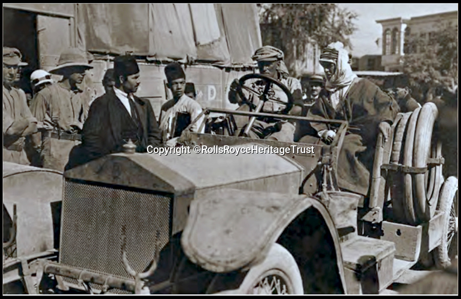 Bournemouth News (01202 558833)<br /> Pic: RollsRoyceHeritageTrust/BNPS<br /> <br /> Triumphant Lawrence and his Army Service Corps driver sitting in 'Blue Mist' in Marjeh Square, Damascus, 2 October, 1918.<br /> <br /> Fascinating never before seen photos of the Arab Revolt have revealed Lawrence of Arabia actually had help from a plucky band of British troops as well as the Arab tribesmen.<br /> <br /> A new book reveals the legendary campaign, that did much to shape the modern map of the Middle East, used cutting edge weapons like Rolls Royce armoured car's and British crewed aircraft to attack the Turkish enemy alongside the native arab army.<br /> <br /> The photos feature in military historian James Stejskal's new book Masters of Mayhem which sheds new light on T.E Lawrence's achievements fighting alongside Arab guerrilla forces in the Middle East during the First World War.<br /> <br /> They had been tucked away in the private photo albums of the descendants of soldiers who fought alongside Lawrence during the campaign.<br /> <br /> One historically important photo shows Lawrence and his driver sitting in a Rolls Royce in Marjeh Square in Damascus after it was captured in October 1918.<br /> <br /> Another documents the dramatic moment a water tower and windmill pump are blown up in the desert.
