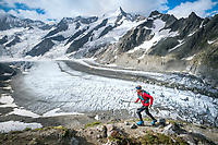 Trail running alongside glaciers on the way to the Strahlegghorn, from Grindelwald, Switzerland