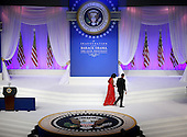 United States President Barack Obama (R) and first lady Michelle Obama walk off of stage after appearing at the Commander-in-Chief Ball on January 21, 2013 in Washington, DC. Pres. Obama was sworn-in for his second term as president during a public ceremonial inauguration earlier in the day. .Credit: Justin Sullivan / Pool via CNP
