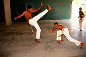 Rio de Janeiro, Brazil. Two young men practising capoeira, martial art dance.