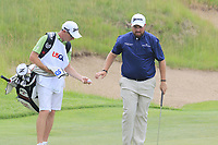 Shane Lowry (IRL) and caddy Dermot Byrne on the 5th green during Saturday's Round 3 of the 117th U.S. Open Championship 2017 held at Erin Hills, Erin, Wisconsin, USA. 17th June 2017.<br /> Picture: Eoin Clarke | Golffile<br /> <br /> <br /> All photos usage must carry mandatory copyright credit (&copy; Golffile | Eoin Clarke)