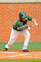 Shane Basen (8) of the Charlotte 49ers lays down a bunt against the Virginia Commonwealth Rams at Robert and Mariam Hayes Stadium on March 30, 2013 in Charlotte, North Carolina.  The 49ers defeated the Rams 9-8 in game one of a double-header.  (Brian Westerholt/Four Seam Images)