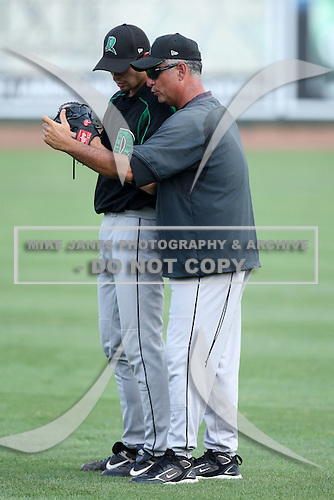 Dayton Dragons pitching coach Todd Benzinger works with Jamie Walczak during a game vs. the Great Lakes Loons at Dow Diamond in Midland, Michigan August 19, 2010.   Great Lakes defeated Dayton 1-0.  Photo By Mike Janes/Four Seam Images