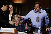Professor Christine Blasey Ford (R), who has accused U.S. Supreme Court nominee Brett Kavanaugh of a sexual assault in 1982, is embraced by her attorneys and a witness at the conclusion of her testimony before a Senate Judiciary Committee confirmation hearing for Kavanaugh on Capitol Hill in Washington, U.S., September 27, 2018. REUTERS/Jim Bourg