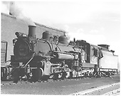 3/4 fireman side view of K-37 #490 beside engine house in Chama.<br /> D&amp;RGW  Chama, NM