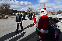 NWA Democrat-Gazette/J.T. WAMPLER Santa greets bikers Sunday Dec. 1, 2019 after the 5th Annual Bikers Toy Run. The biker communities of NWA  came together to provide presents to children on Washington and Madison Counties with a toy run from north Fayetteville to Greenland High School where the toys were distributed to children by Santa.