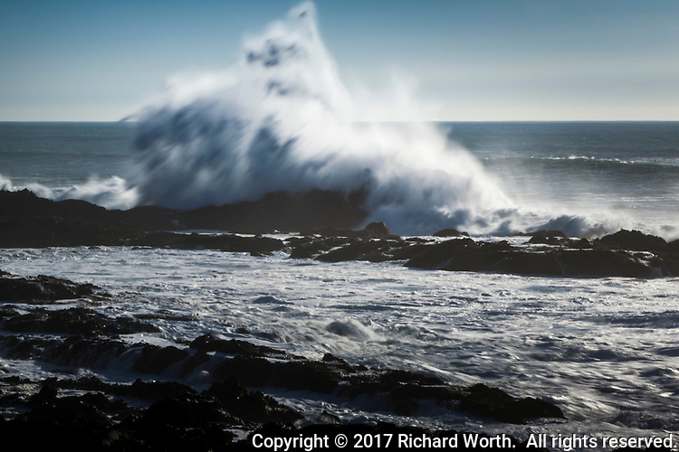 Although skies were mostly clear, the waves were crashing into the rocks off Bean Hollow State Beach on the California coast.