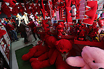 Palestinian vendors display flowers red teddy bears and pillows on Valentine's day in Gaza on February 14, 2016. Valentine's Day is increasingly popular in the region as people have taken up the custom of giving flowers, cards, chocolates and gifts to sweethearts to celebrate the occasion. Photo by Mohammed Asad