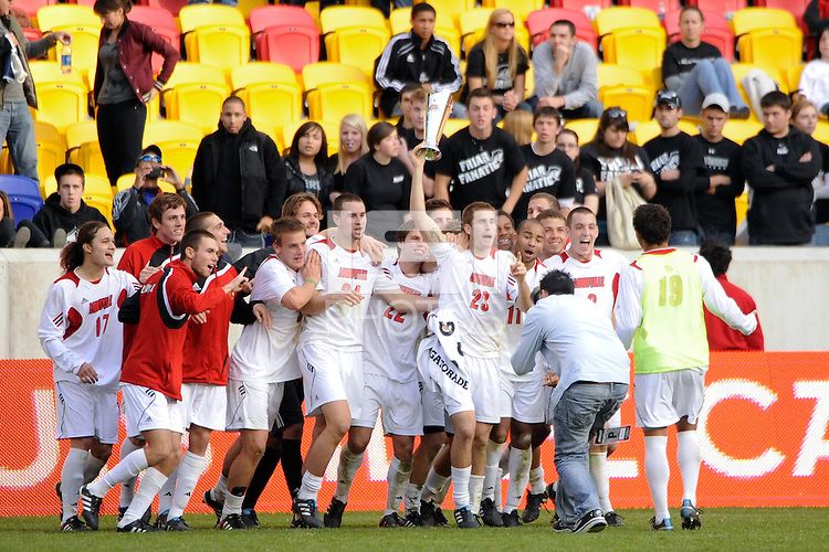 J.T. Murray (23) of the Louisville Cardinals celebrates with teamates. The Louisville Cardinals defeated the Providence Friars 3-2 in penalty kicks after playing to a 1-1 tie during the finals of the Big East Men's Soccer Championship at Red Bull Arena in Harrison, NJ, on November 14, 2010.