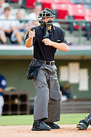 Home plate umpire David Soucy makes a strike call during the International League game between the Durham Bulls and the Charlotte Knights at Knights Stadium on August 2, 2011 in Fort Mill, South Carolina.  The Bulls defeated the Knights 18-3.   (Brian Westerholt / Four Seam Images)