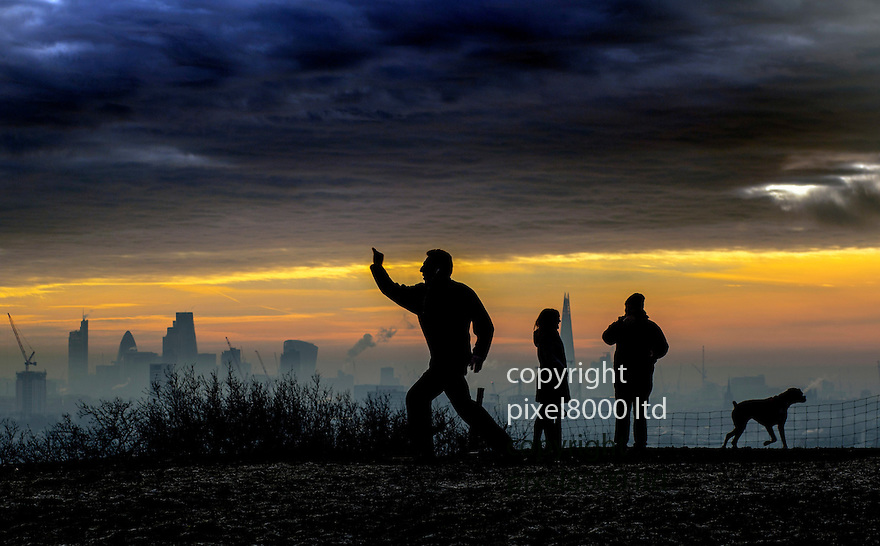 Pic shows: Coldest night of the year brings frost to Hampstead Heath and beautiful misty light to the City of London skyline.<br /> <br /> Man practices karate on the brow of the hill<br /> <br /> <br /> <br /> <br /> Pic by Gavin Rodgers/Pixel 8000 Ltd