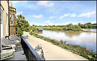BNPS.co.uk (01202 558833)<br /> Pic: Riverhomes/BNPS<br /> <br /> Stunning views...<br /> <br /> Buy a bit of London Pride...Red Lion House was once the pub attached to the famous Fullers brewery in Chiswick.<br /> <br /> Yours for &pound;8million - Beer fans with deep pockets will want to get their hands on this famous former pub - as it's all but attached to the historic Fullers brewery by the Thames in Chiswick.<br /> <br /> Red Lion House, on exclusive Chiswick Mall in west London, was originally built as a pub more than 300 years ago for Thomas Mawson's brewery, which went on to become Fuller's in 1845.<br /> <br /> Back in the 18th and 19th centuries, the pub would have been a bustling hive of activity with boat crews and carters as regular customers, but it is now a tranquil and elegant riverside home.<br /> <br /> It does have an incredible wine cellar with a barrelled ceiling that is perfect for hosting parties if the new owners want to play publican.