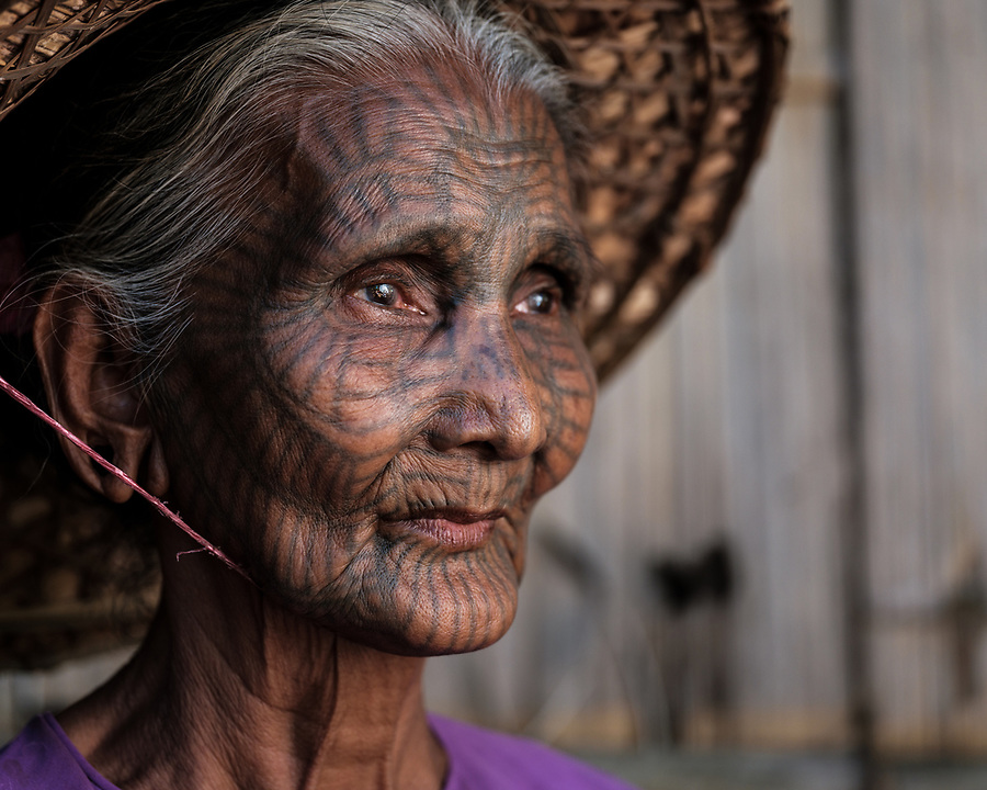 MRAUK U, MYANMAR - CIRCA DECEMBER 2017: Portrait of woman with tattoo face from a Chin Village in the remote area of Mrauk U, Rakhine State.