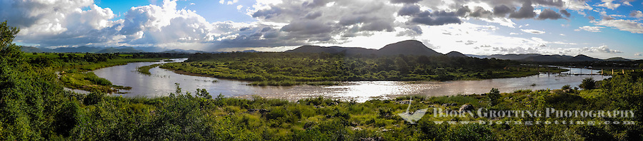 Panorama view from Pestana Kruger Lodge towards the Kruger National Park, South Africa. Elephant herd on other side of river.