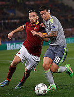 Calcio, andata degli ottavi di finale di Champions League: Roma vs Real Madrid. Roma, stadio Olimpico, 17 febbraio 2016.<br /> Roma's Kostas Manolas, left, and Real Madrid's James Rodriguez fight for the ball during the first leg round of 16 Champions League football match between Roma and Real Madrid, at Rome's Olympic stadium, 17 February 2016.<br /> UPDATE IMAGES PRESS/Riccardo De Luca