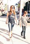 AbilityFilms@YAHOO.COM.805 427 3519.www.AbilityFilms.com...June 6th 2012..Charisma Carpenter & son Donovan strolling in Beverly Hills wearing a pink floyd shirt