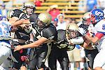 Palos Verdes, CA 09/24/10 - Tommy Webster (Peninsula #49), Delmar Garcia (Peninsula #64) and Blake Allman (Peninsula #77)  in action during the Serra-Peninsula varsity football game at Peninsula High School.