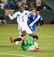 CARSON, CA – June 6, 2011: Guatemala goalie Ricardo Jerez (1) catches and protects the ball from Houduras player Jerry Bengston (9) during the match between Guatemala and Honduras at the Home Depot Center in Carson, California. Final score Guatemala 0, Honduras 0.