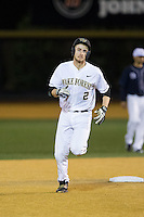 Johnny Aiello (2) of the Wake Forest Demon Deacons rounds the bases after hitting a solo home run against the Georgetown Hoyas at David F. Couch Ballpark on February 19, 2016 in Winston-Salem, North Carolina.  The Demon Deacons defeated the Hoyas 3-1.  (Brian Westerholt/Four Seam Images)