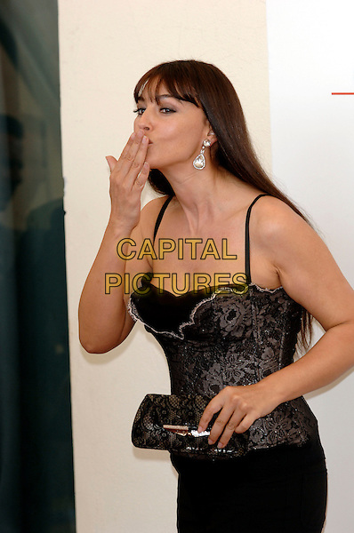 """MONICA BELLUCCI.photocall for """"The Bothers Grimm"""".62nd International Film Festival,.Venice, 4th September 2005.half length La Biennale black corset strappy lace top skirt diamond dimante earrings clutch bag purse blow blowing kiss hand mouth.Ref: PL.www.capitalpictures.com.sales@capitalpictures.com.©Capital Pictures."""