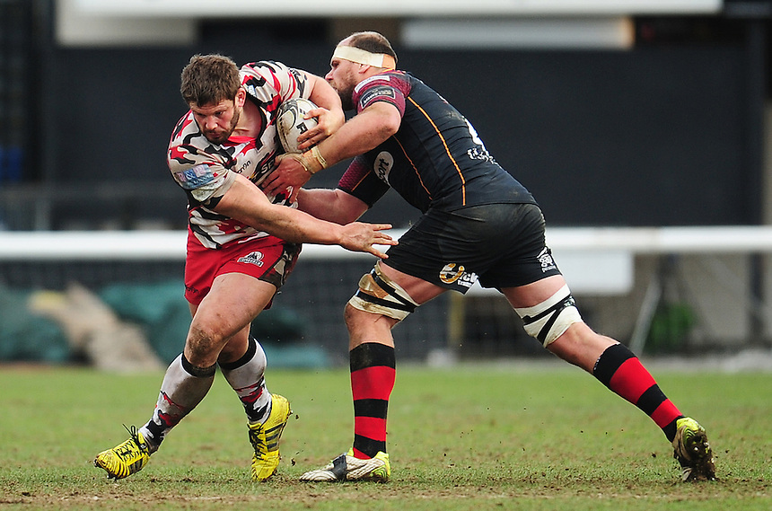 Edinburgh's Ross Ford evades the tackle of Dragons' Cory Hill<br /> <br /> Photographer Kevin Barnes/CameraSport<br /> <br /> Rugby Union - Guinness PRO12 Round 18 - Newport Gwent Dragons v Edinburgh Rugby - Sunday 27th March 2016 - Rodney Parade - Newport<br /> <br /> &copy; CameraSport - 43 Linden Ave. Countesthorpe. Leicester. England. LE8 5PG - Tel: +44 (0) 116 277 4147 - admin@camerasport.com - www.camerasport.com