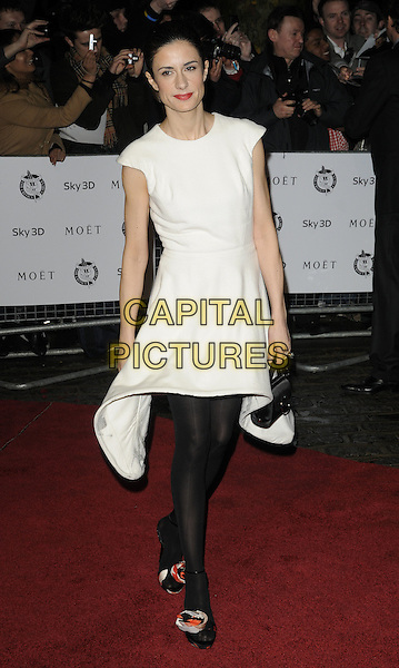 LIVIA GIUGGIOLI.London Critics' Circle Film Awards at BFI Southbank, London, England..February 10th 2011.ALFS full length black dress white tights handbag couture.CAP/CAN.©Can Nguyen/Capital Pictures.