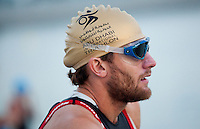 13 MAR 2010 - ABU DHABI, UAE - Race favourite Faris Al-Sultan prepares himself before the start of the Abu Dhabi International Triathlon (PHOTO (C) NIGEL FARROW)