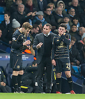 Celtic Manager Brendan Rogers during a break in play with Patrick Roberts (on loan from Man City) of Celtic holding his mouth during the UEFA Champions League GROUP match between Manchester City and Celtic at the Etihad Stadium, Manchester, England on 6 December 2016. Photo by Andy Rowland.