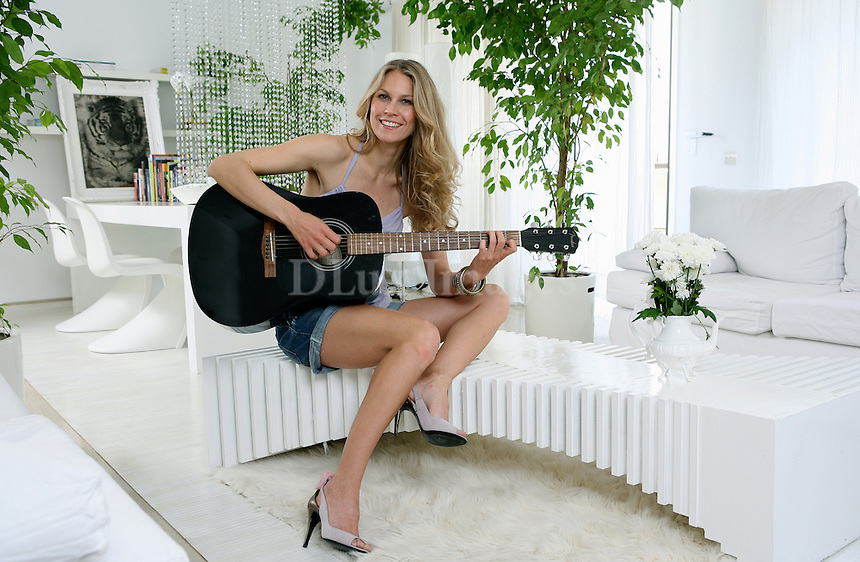 Born in Sweden, Katia Margaritoglou had a career in Athens as a top model and is now an interior designer.   This house she decorated for a friend and used white throughout the house.