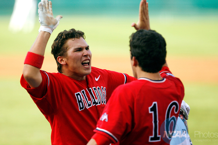 25 JUNE 2008:  Danny Muno (16) congratulates Steve Detwiler (15) of Fresno State University after his home run against the University of Georgia during the Division I Men's Baseball Championship held at Rosenblatt Stadium in Omaha, NE.  Fresno State defeated Georgia 6-1 for the national title.  Jamie Schwaberow/NCAA Photos