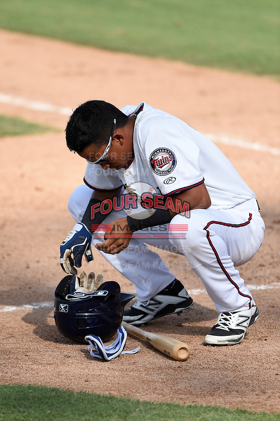Fort Myers Miracle shortstop Engelb Vielma (7) takes off his batting gloves after striking out during a game against the St. Lucie Mets on April 19, 2015 at Hammond Stadium in Fort Myers, Florida.  Fort Myers defeated St. Lucie 3-2 in eleven innings.  (Mike Janes/Four Seam Images)
