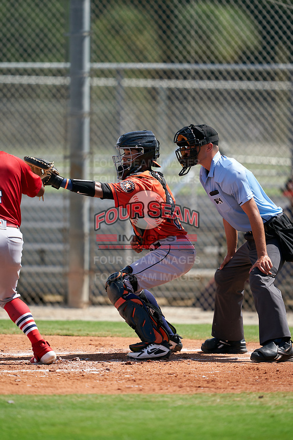 GCL Astros catcher Jose Alvarez (6) and umpire Kaleb Martin during a Gulf Coast League game against the GCL Cardinals on August 11, 2019 at Roger Dean Stadium Complex in Jupiter, Florida.  GCL Cardinals defeated the GCL Astros 2-1.  (Mike Janes/Four Seam Images)