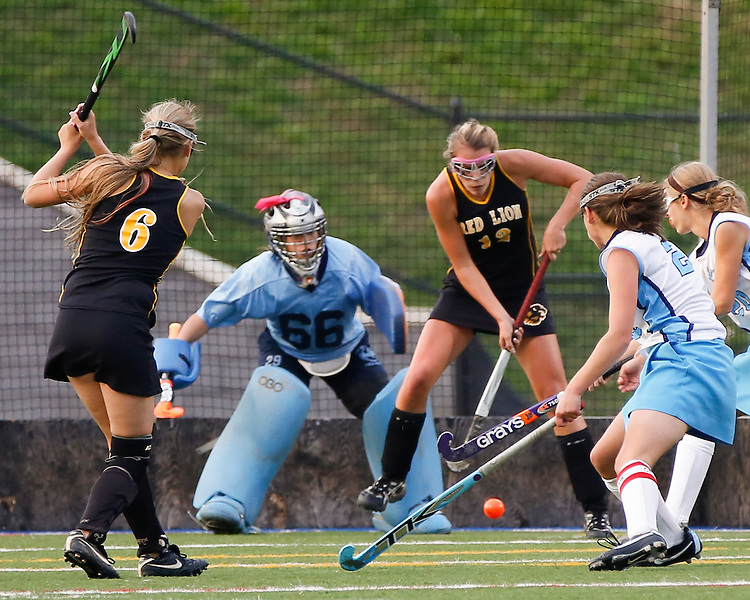 Red Lion's Hailey Orwig, left, makes the team's second goal of the night against Dallastown. The teams battled through two scoreless overtimes before Dallastown won in a shootout. (For the Daily Record/Sunday News -- Shane Keller)