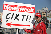 Newsweek is published in Turkish, October 2008. Banner is held in Taksim Square, Istanbul