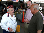 WWII Vet Arnie Bocksell of Syosset, Gary Lewi of the American Airpower Museum and Newsday reporter, Arnie Abrams at Republic Airport Farmingdale to witness the arrival of a B-29 Bomber at the American Airpower Museum on Monday June 7, 2004. (Newsday Photo / Jim Peppler).