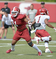 NWA Democrat-Gazette/ANDY SHUPE<br /> Arkansas defensive back Chevin Calloway (left) defends against receiver Jared Cornelius during a drill Tuesday, Aug. 7, 2018, during practice at the university practice fields in Fayetteville. Visit nwadg.com/photos to see more photographs from the practice.