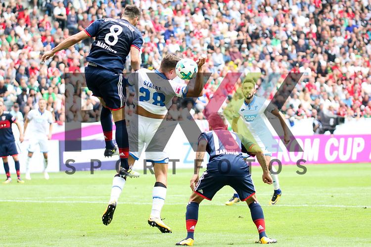 Hoffenheims Adam Szalai (Nr.28) hoch zum Kopfball gegen Muenchens Javi Martinez (Nr.8)  beim Telekom Cup 2017 Bayern Muenchen - TSG Hoffenheim.<br /> <br /> Foto &copy; PIX-Sportfotos *** Foto ist honorarpflichtig! *** Auf Anfrage in hoeherer Qualitaet/Aufloesung. Belegexemplar erbeten. Veroeffentlichung ausschliesslich fuer journalistisch-publizistische Zwecke. For editorial use only.