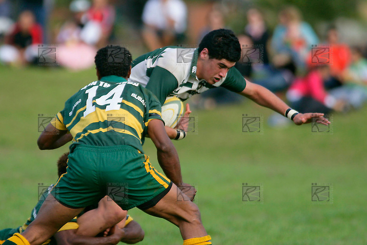 Jamie Metcalf braces himself as he is brought to ground. Counties Manukau Premier Club Rugby, Pukekohe v Manurewa  played at the Colin Lawrie field, on the 17th of April 2006. Manurewa won 20 - 18.