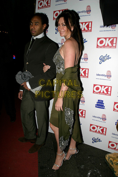 SUZI PERRY & GUEST.OK! Magazine VIP Christmas Karaoke Party at Papageno, London, UK..December 14th, 2005.Ref: AH.full length Roubi L'Roubi dress green arms linked halterneck.www.capitalpictures.com.sales@capitalpictures.com.© Capital Pictures.