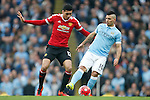 Chris Smalling of Manchester United and Sergio Aguero of Manchester City during the Barclays Premier League match at Old Trafford. Photo credit should read: Philip Oldham/Sportimage