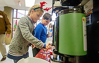 STAFF PHOTO JASON IVESTER --12/18/2014--<br /> Kaylee (cq) Vorisek (cq) mixes hot chocolate for customers on Thursday, Dec. 18, 2014, inside Sugar Creek Elementary School in Bentonville. Third-graders at the school sold hot chocolate and snacks to students and staff to raise money for the Northwest Arkansas Children's Shelter.