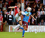 Paul Coutts of Sheffield Utd wins the ball in front of Stephen Dawson of Scunthorpe Utd during the English League One match at Glanford Park Stadium, Scunthorpe. Picture date: September 24th, 2016. Pic Simon Bellis/Sportimage