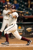 Arizona State catcher Petey Paramore (13) follows through on his swing versus Texas A&M at the 2007 Houston College Classic at Minute Maid Park in Houston, TX, Friday, February 9, 2007.  Arizona State defeated Texas A&M 5-4.